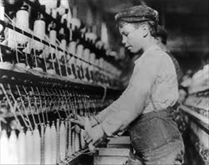 Young boy working at a mill